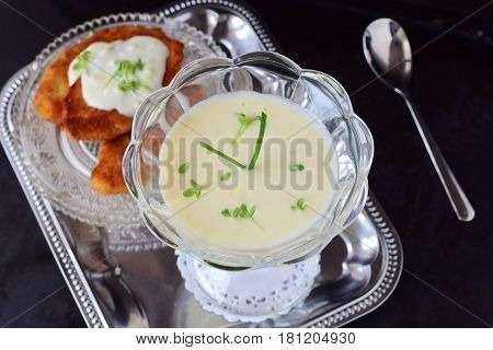 Simple easy to cook milk based gravy in a glass on a metal tray. Healthy food concept