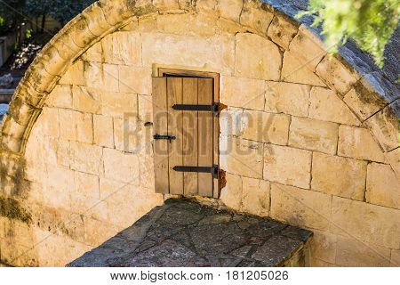 A small door in an attic in the shape of a church in the courtyard of an old European castle