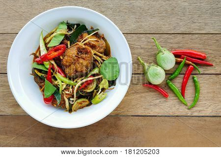 Spicy fried stir catfish with chilli paste Thai spicy herb food.