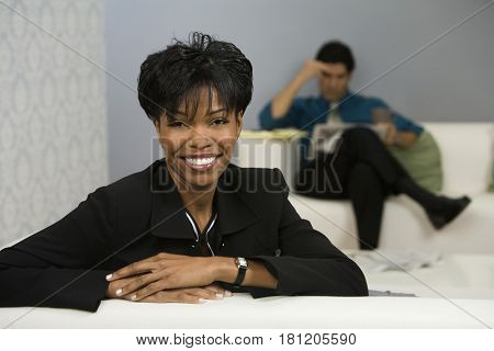 African businesswoman leaning sofa