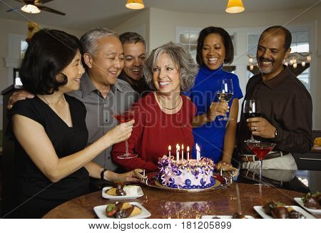 Woman celebrating birthday with multi-ethnic friends