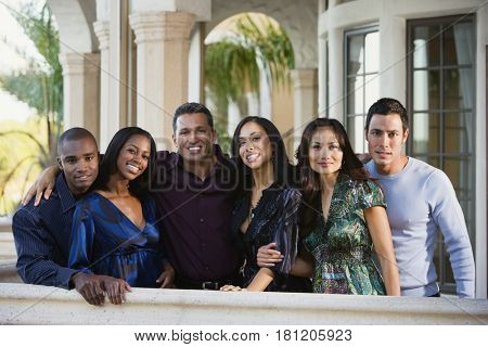 Multi-ethnic friends on balcony