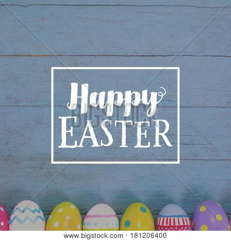 Easter greeting against various easter eggs arranged on wooden surface