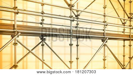 Digital composite of 3D grey scaffolding whit soft yellow background