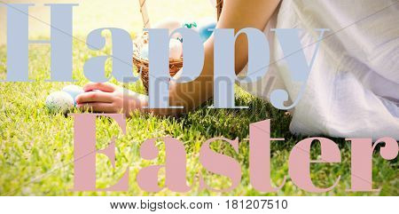 Little girl collecting easter eggs against happy easter logo