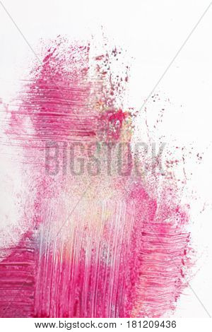 Abstract blurred graffiti, street art. Creative abstractionism, sprayed magenta color on white background.