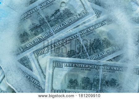 100 dollars frozen melt. Banknotes frozen in ice.