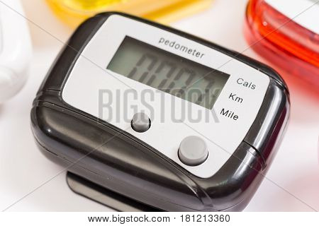 Pile Of Digital Plastic Pedometers Over White Background