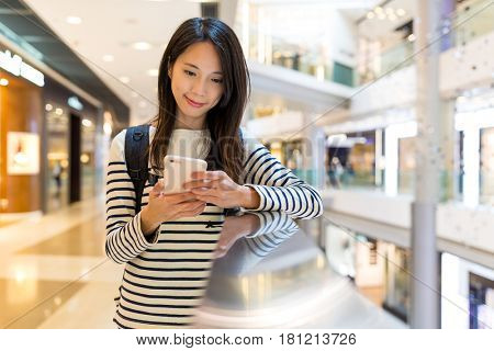 Woman checking on cellphone