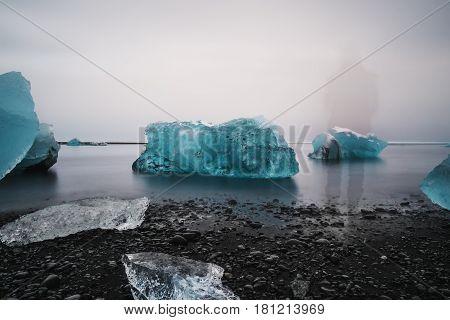 Ice Beach at Jokulsarlon glacier lagoon with spirit standing alone