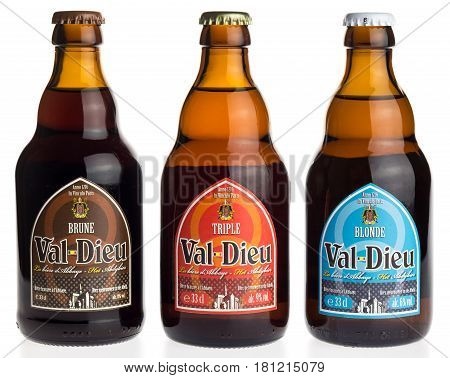 GRONINGEN, NETHERLANDS - APRIL 7, 2017: Bottle of Belgian Val Dieu Brune, Triple and Blonde beer isolated on a white background