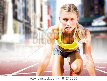Digital composite of Woman runner on track in blurry city