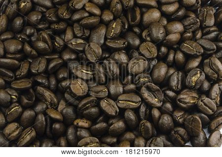 Macro Close-up View Of A Lot Of Coffee Beans Laying On Table
