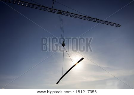 steel pulley silhouette on the blue sky