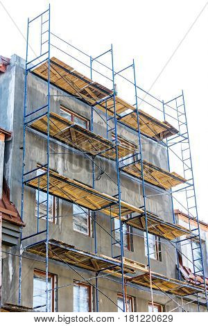 Construction Site. Scaffolding Platforms For Work On A New Apartment Building.