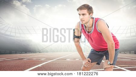 Digital composite of Male runner with headphones on track against flares