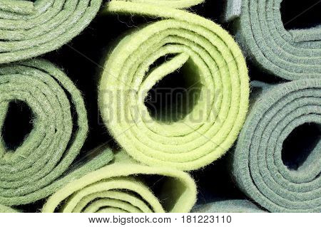 big rolls of cloth and felt for sale in the shop for amateur tailors