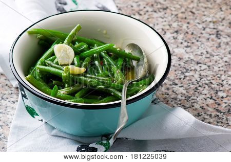 braised green beans with garlic. selective focus