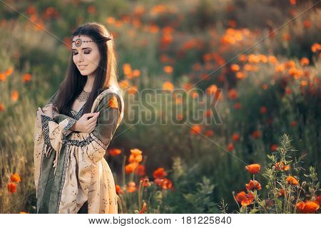 Beautiful Medieval Queen Daydreaming in a Field of Poppies