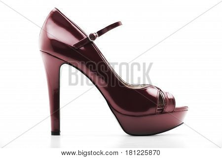 cloes up high heel shoe on the white backgroud