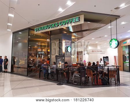BANGKOK THAILAND - MARCH 30 : Starbucks coffee cafe at Central Chaengwattana department store on March 30 2017 in Bangkok Thailand.