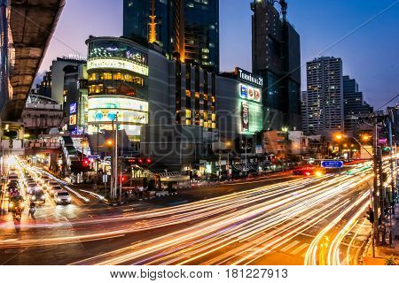 BANGKOK, THAILAND-April 01, 2017: Night scene of Terminal 21, famous shopping mall, located near Asoke intersection with car light trails at Bangkok, Thailand