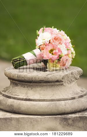 Wedding bouquet  in pink, yellow and ivory colors