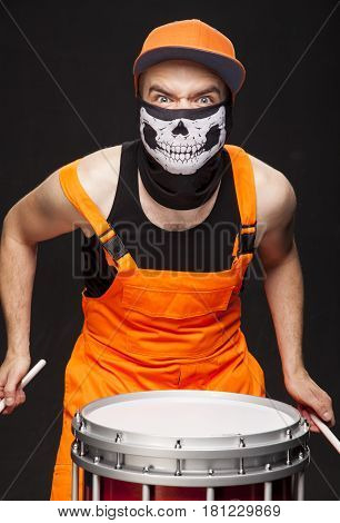 Angry Drummer On A Black Background