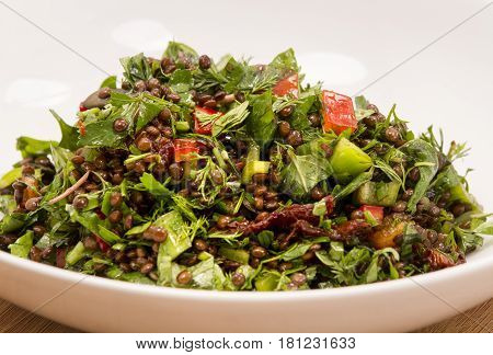 healhy and fresh lentil salad with greens