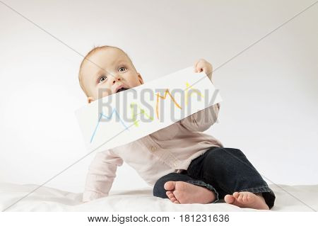 Cute baby with poster with a sign Mama. Infant boy holding greeting card for Mothers day