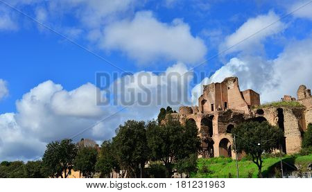 Imperial Palace ancient ruins at the top of Palatine Hill in Rome panoramic view with beautiful clouds
