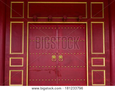 Blood-red Wooden Door