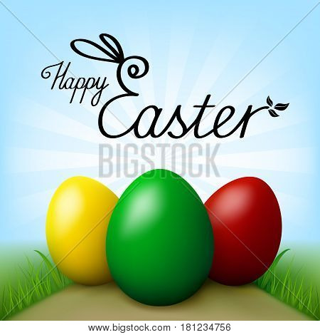 Happy Easter. Three eggs of different colors (green, yellow,red) on path in field with green grass, inscription