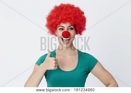 Thumbs up clown in red wig studio