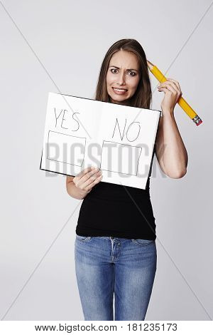 Beautiful woman with referendum choice portrait studio shot