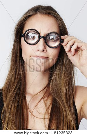 Beautiful woman with geeky spectacles portrait studio shot