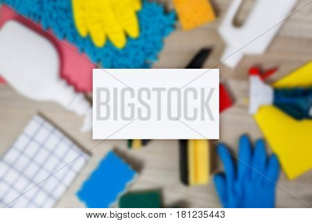Business card mockup. House cleaning products. Sponges and chemicals bottles. Rubber gloves, towel and washcloth. Household equipment.