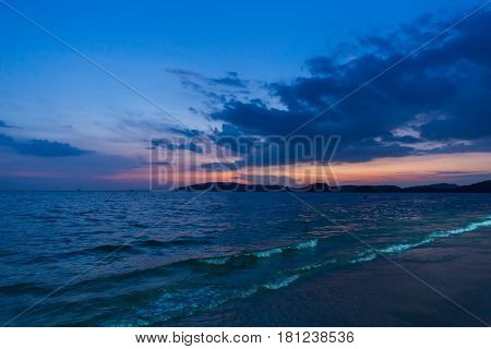 sea beach when sunset dusk blue dark sky.