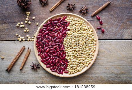 red beans and soy beans in dish on wooden table