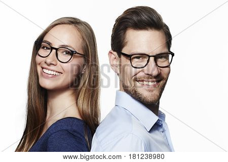 Beautiful couple in spectacles portrait studio shot