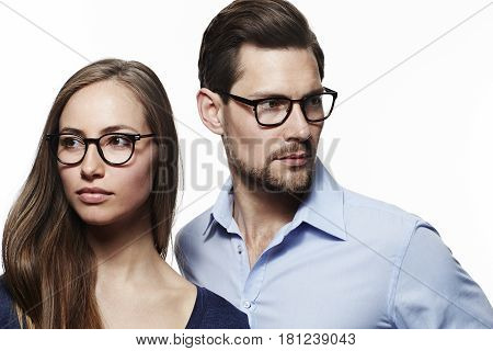 Spectacles couple looking away in studio shot