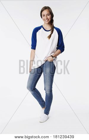 Cool woman in raglan top smiling studio shot