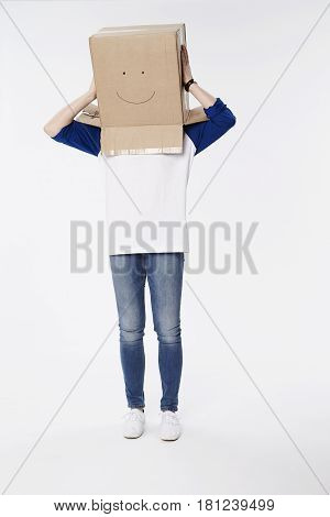 Woman wearing box with smiley face studio shot