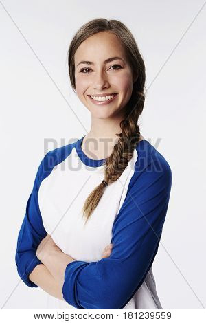 Smiling young woman in raglan top portrait