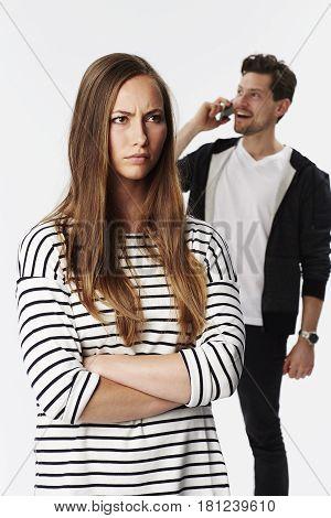 Beautiful brunette annoyed at boyfriend on phone