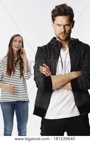 Angry boyfriend ignored by girlfriend portrait studio shot