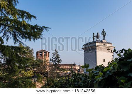 Statues with clock on Loggia di San Giovanni in Udine Italy
