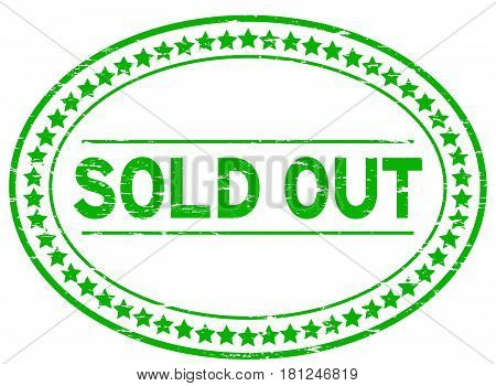 Grunge green sold out oval rubber seal stamp on white background