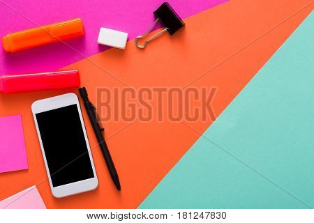 Creative minimal design - flat lay of workspace desk with stationery, mobile smart phone, copy space. Template, mockup, objects