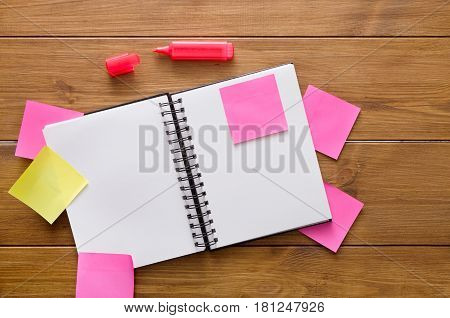 Don't forget things. Stationery supplies, top view flat lay shot of office wooden desk with open notepad, pen and many colorful blank memory stickers and memo notes, nobody, copy space, template